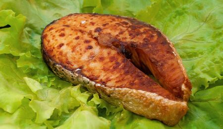 Grilled Atlantic Salmon Steaks on salad leaves