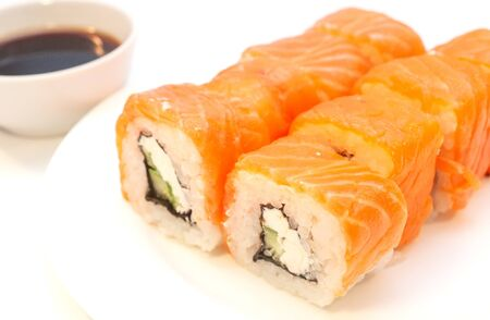 Rolls with salmon soy sauce on a plate Banco de Imagens