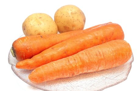 Potatoes and carrots isolated on white Banco de Imagens