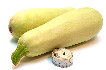 Courgettes and measuring tape isolated on white background Banco de Imagens
