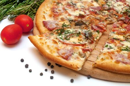 Fresh tomato, mushroom, cheese and sausage pizza on a round board isolated on white