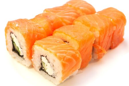 Philadelphia rolls with salmon soy sauce on a white Banco de Imagens