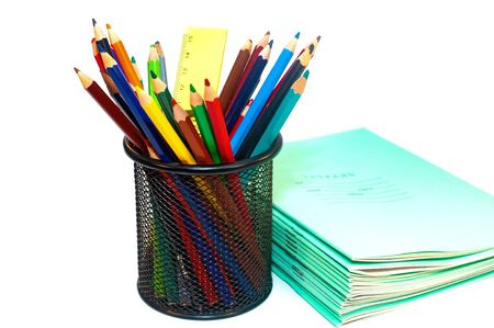 Color pencils and notebooks for school isolated on white Banco de Imagens