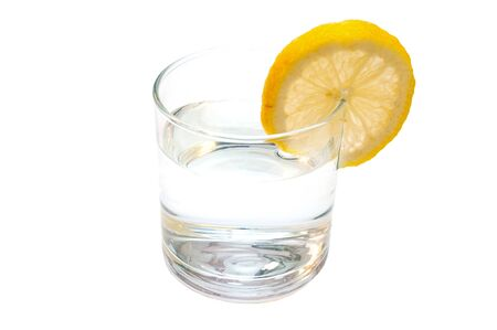Glass of pure water with lemon isolated on a white background Banco de Imagens