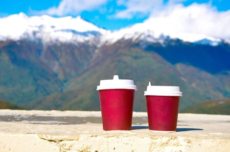 Coffee to go on a background of the Caucasus Mountains Banco de Imagens