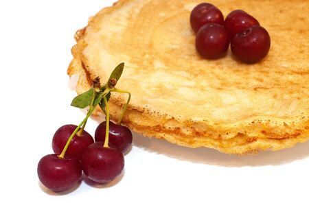 Pancakes for breakfast with cherry berries isolated on white