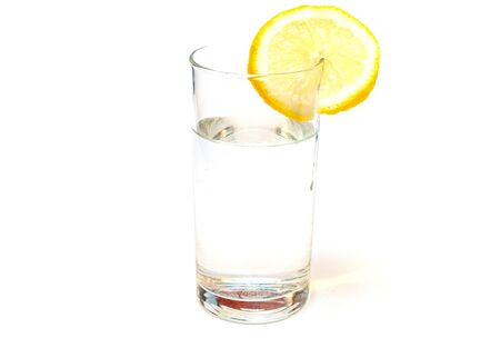 Glass of pure still water with lemon isolated on a white background