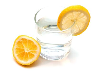 Glass of pure water with lemon isolated on a white background Banque d'images