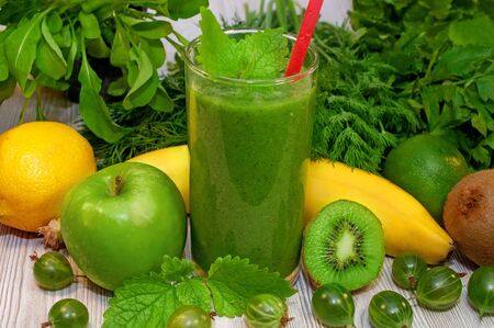 Kiwi, banana, apple and fresh greens smoothie for detox cleansing