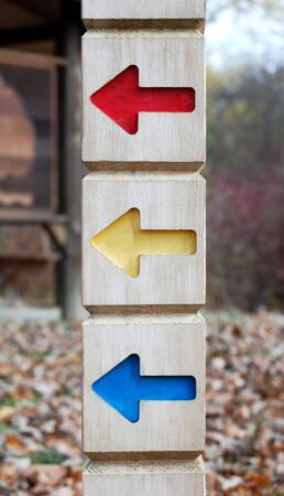 directional sign with red yellow and blue arrows Stok Fotoğraf