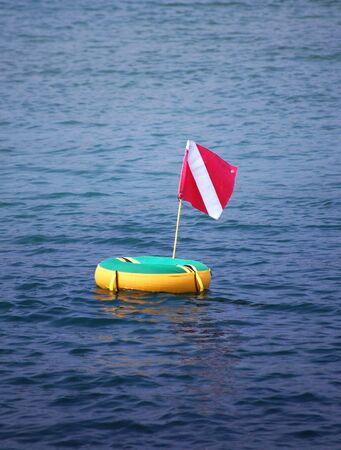 scuba flag on floater in bay