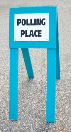 polling: Polling place sign, blue wood on ground Stock Photo