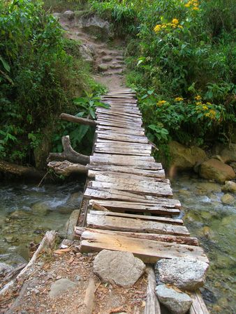 rickety: Rickety wooden bridge on the way to the Mandor waterfalls near Machu Picchu  Stock Photo