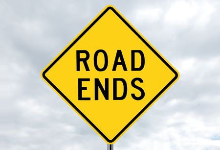 ends: road sign - road ends, black on yellow, in clouds Stock Photo