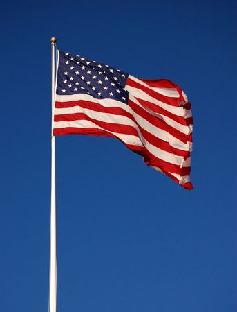 flapping: American flag flapping, with clear sky background, vertical