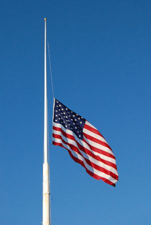 American flag at half mast, flag down