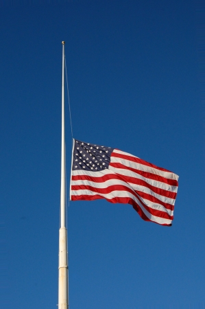 American flag at half mast, flag flapping photo