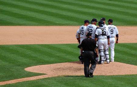 DETROIT, MI - JULY 11: Detroit Tigers players hold a conference at the mound during their loss to the Minnesota Twins on July 11, 2010 in Detroit, Michigan. Editorial