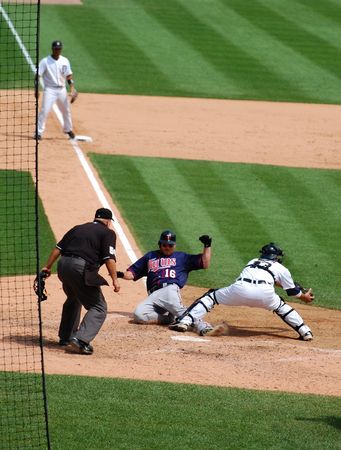hardball: DETROIT, MI - JULY 11: Jason Kubel of the Minnesota Twins slides into home during a game against the Detroit Tigers on July 11, 2010 in Detroit, Michigan.