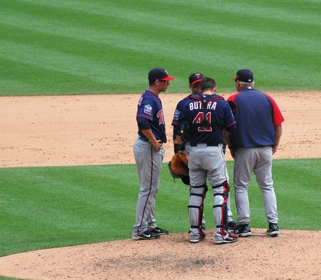 DETROIT, MI - JULY 11: Minnesota Twins players hold a conference at the mound during their game against the Detroit Tigers on July 11, 2010 in Detroit, Michigan.