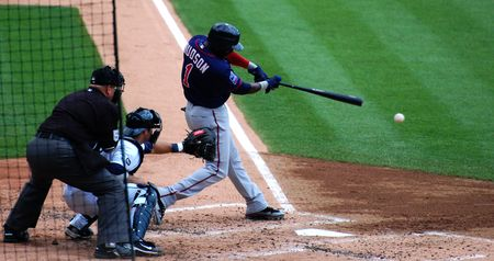 majors: DETROIT, MI - JULY 11: Orlando Hudson of the Minnesota Twins hits the ball during a game against the Detroit Tigers on July 11, 2010 in Detroit, Michigan.