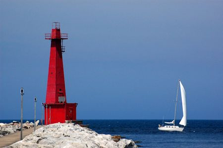 lake michigan lighthouse: Muskegon faro y velero, lago Michigan, Muskegon, MI