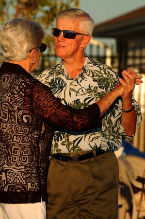 Senior couple dancing, with sunglasses photo