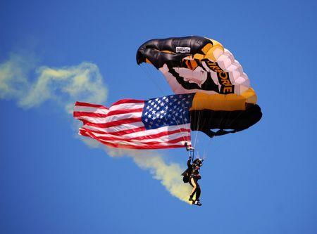 ANN ARBOR, MI - OCTOBER 09: 101st Airborne Division Parachute Demonstration Team member parachutes into Michigan Stadium before the Michigan vs. Michigan State football game October 9, 2010.