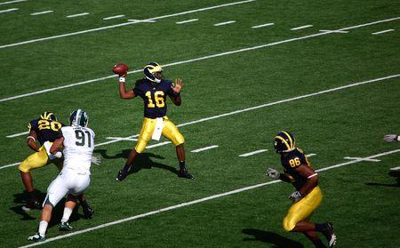michigan state: ANN ARBOR, MI - OCTOBER 09: Denard Robinson throws a pass during the Michigan vs. Michigan State football game October 9, 2010. Michigan lost the game 34-17.