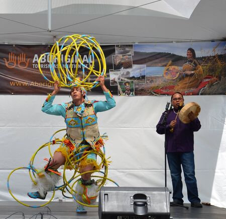 concludes: Vancouver, BC - June 26:  World-champion Hoop Dancer Alex Wells concludes his performance at the National Aboriginal Awareness Celebration, June 26, 2011. Editorial