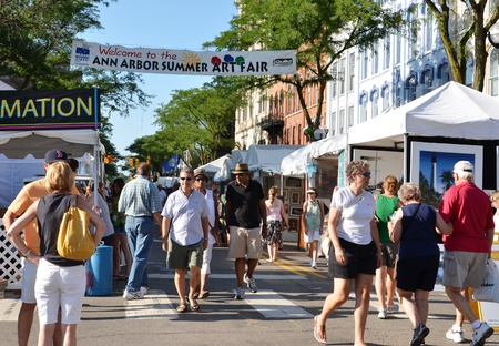 ANN ARBOR, MI - JULY 20: Crowds enjoy the Ann Arbor Summer Art Fair in Ann Arbor, MI. Organized by The Guild of Artists and Artisans, it is one of four art fairs in Ann Arbor July 20-23, 2011. Stock Photo - 10006480