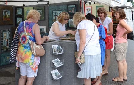 linda: ANN ARBOR, MI - JULY 23: Artist Linda Chamberlain discusses her work with admirers at the Ann Arbor Art Fair in Ann Arbor, MI, July 23, 2011.