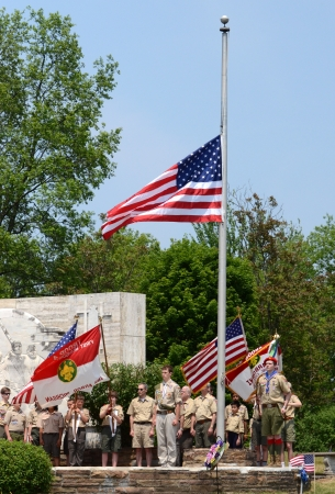 ANN ARBOR, MI - MAY 27: Boy scouts after placing the flag at half mast at the annual Memorial Day observance on May 27, 2012 at Arborcrest Memorial Park in Ann Arbor, MI Sajtókép