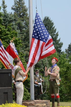 ANN ARBOR, MI - MAY 27: Boy scouts raise the flag at the Memorial Day observance on May 27, 2012 at Arborcrest Memorial Park in Ann Arbor, MI