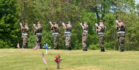 ANN ARBOR, MI - MAY 27: Members of the military fire a salute at the annual Memorial Day observance on May 27, 2012 at Arborcrest Memorial Park in Ann Arbor, MI