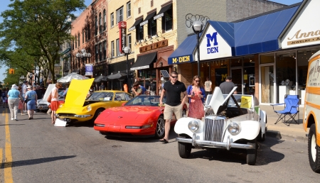ANN ARBOR, MI - JULY 13: 1955 MG, 1994 Corvette, and 1970 Ferrari at the Rolling Sculpture car show July 13, 2012 in Ann Arbor, MI. Stock Photo - 14514475