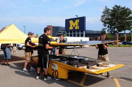 ANN ARBOR, MI - JULY 16: Western Michigan University's solar car team members dismantling their car at the American Solar Challenge stop July 16, 2012 in Ann Arbor, MI.