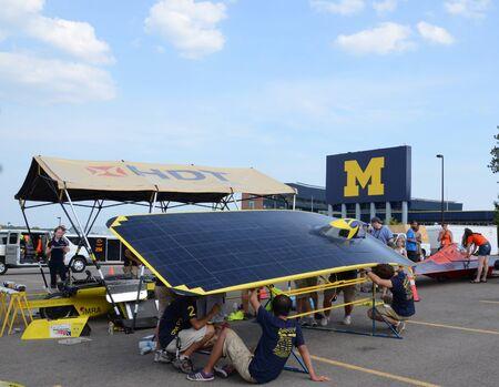ANN ARBOR, MI - JULY 16: University of Michigan solar car team at the American Solar Challenge stop July 16, 2012 in Ann Arbor, MI.