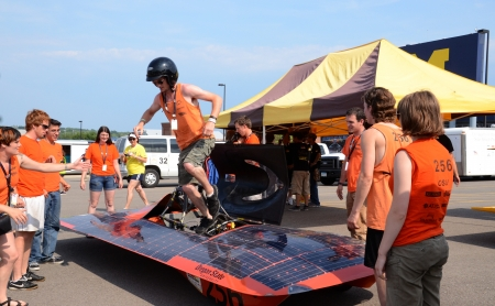 ANN ARBOR, MI - JULY 16: Oregon State University?s solar car team driver exiting the car at the American Solar Challenge stop July 16, 2012 in Ann Arbor, MI.