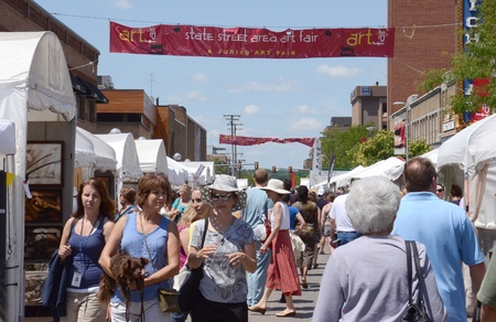 ANN ARBOR, MI - JULY 20: Crowds at the State Street Area Art Fair, one of four art fairs taking place in Ann Arbor July 18-21, 2012.