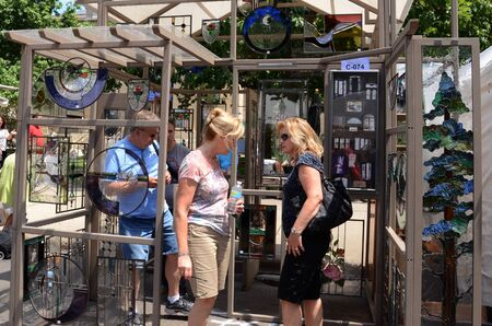 linda: ANN ARBOR, MI - JULY 20: Visitors admiring Linda Kirkwoods glasswork the Ann Arbor Summer Art Fair.  It is one of four art fairs taking place in Ann Arbor July 18-21, 2012.