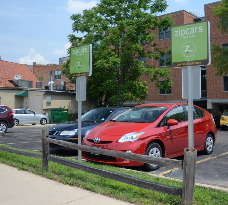 ANN ARBOR, MICHIGAN - JUNE 21: Zipcar, with cars available at locations such as the one shown here on June 21, 2013, was purchased by Avis in January 2013.  Editöryel
