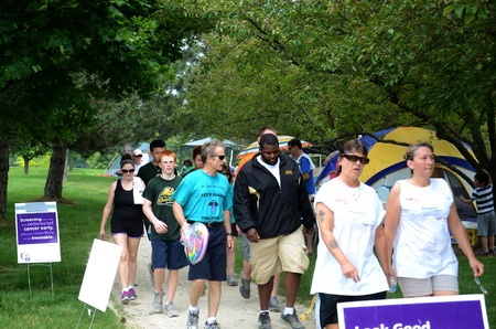 marchers: ANN ARBOR, MI - JUNE 22: Marchers at the Relay for Life of Ann Arbor event on June 22, 2013 in Ann Arbor, MI.