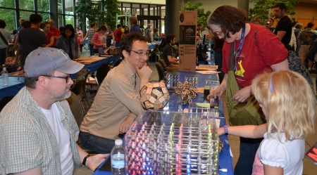 ANN ARBOR, MI - JUNE 8: Attendees explore the Hypnocube at the Ann Arbor Mini Maker Faire June 8, 2013 in Ann Arbor, MI Editorial