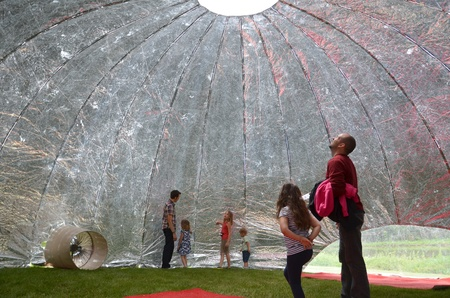 ANN ARBOR, MI - JUNE 8: Attendees explore the Cloud Bean mylar inflatable shelter at the Ann Arbor Mini Maker Faire June 8, 2013 in Ann Arbor, MI Editorial
