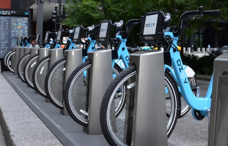 adams: CHICAGO - JULY 18: Bicycle rental station in downtown Chicago, shown July 18, 2013. Within the first month of operation over 50,000 trips have been taken through Chicagos Divvy Program.