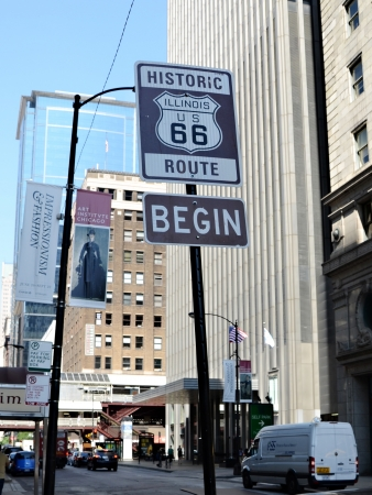CHICAGO - JULY 19: Sign on Adams Street in Chicago, shown on July 19, 2013, marks the start of the famous Route 66, which goes from Chicago to Los Angeles.