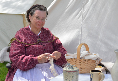DEARBORN, MI - MAY 26: Civil-war era re-enactor tatting during the Civil War remembrance at Greenfield Village May 26, 2013.