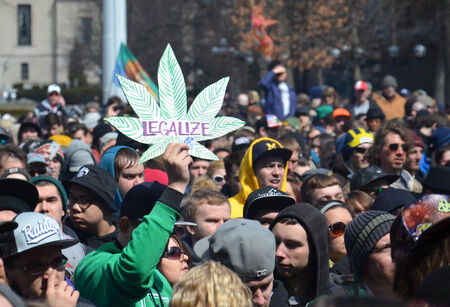 ANN ARBOR, MI - APRIL 5: A participant holds up a sign at the 43rd annual Hash Bash rally in Ann Arbor, MI April 5, 2014.