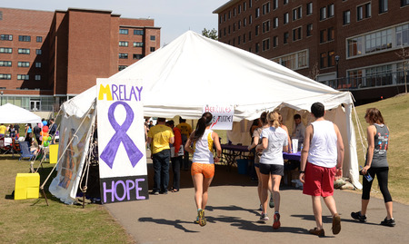 marchers: ANN ARBOR, MI - APRIL 12: Participants enter a tent at the University of Michigans Relay for Life event on April 12, 2014 in Ann Arbor, MI.